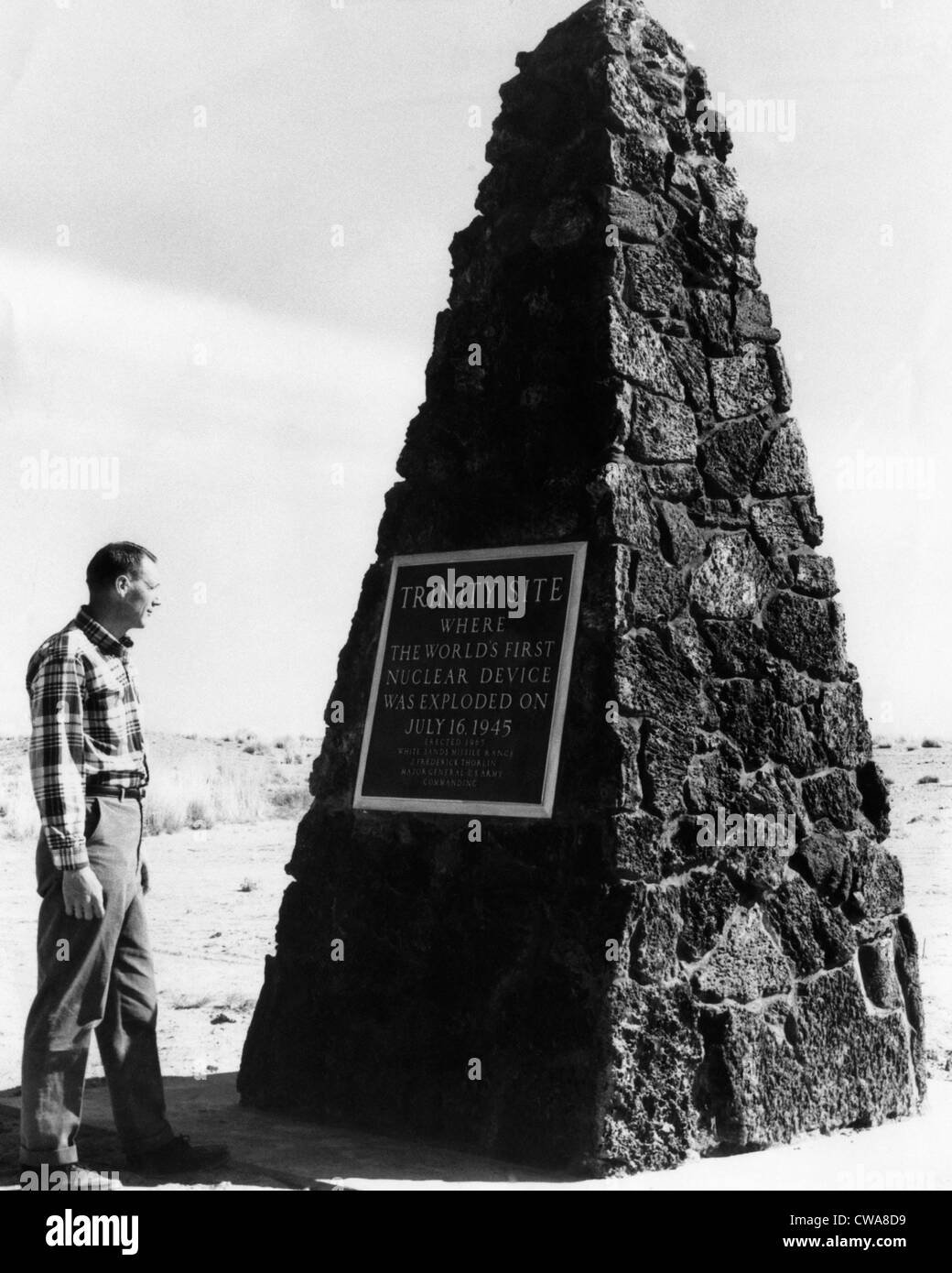 A man reading the plaque on a monument at The Trinity Site, where the first atomic explosion took place, Socorro, Stock Photo