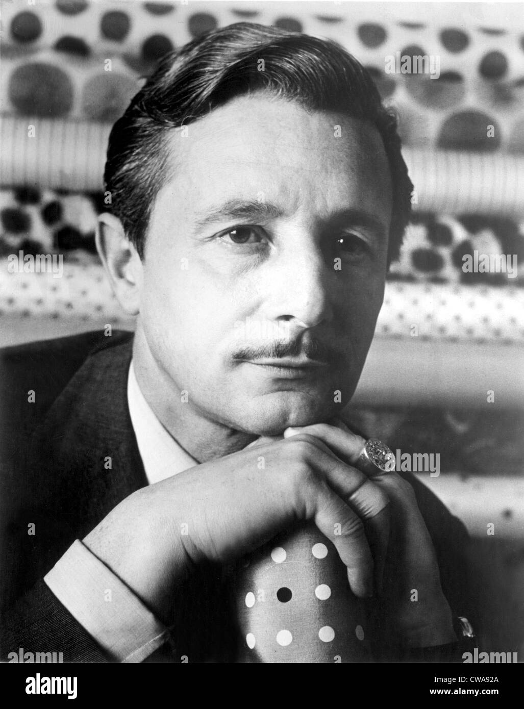 Oleg Cassini in a 1950s portrait.. Courtesy: CSU Archives / Everett Collection - Stock Image