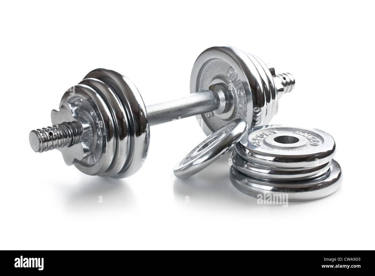 Chromed fitness dumbbell on white background - Stock Image