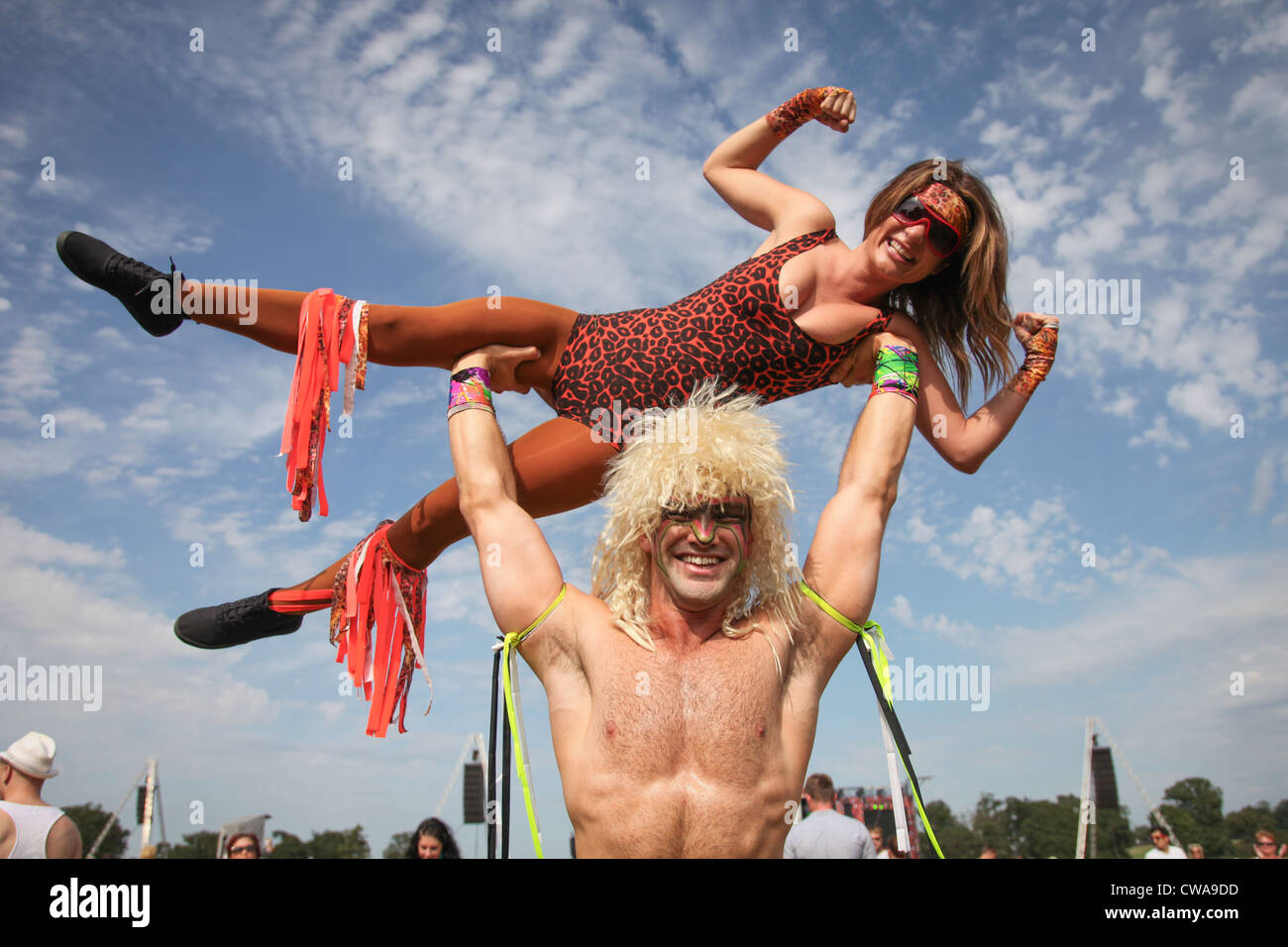 Music fans dressed as wrestlers at V Festival in Hylands Park, Chelmsford, Essex - Stock Image