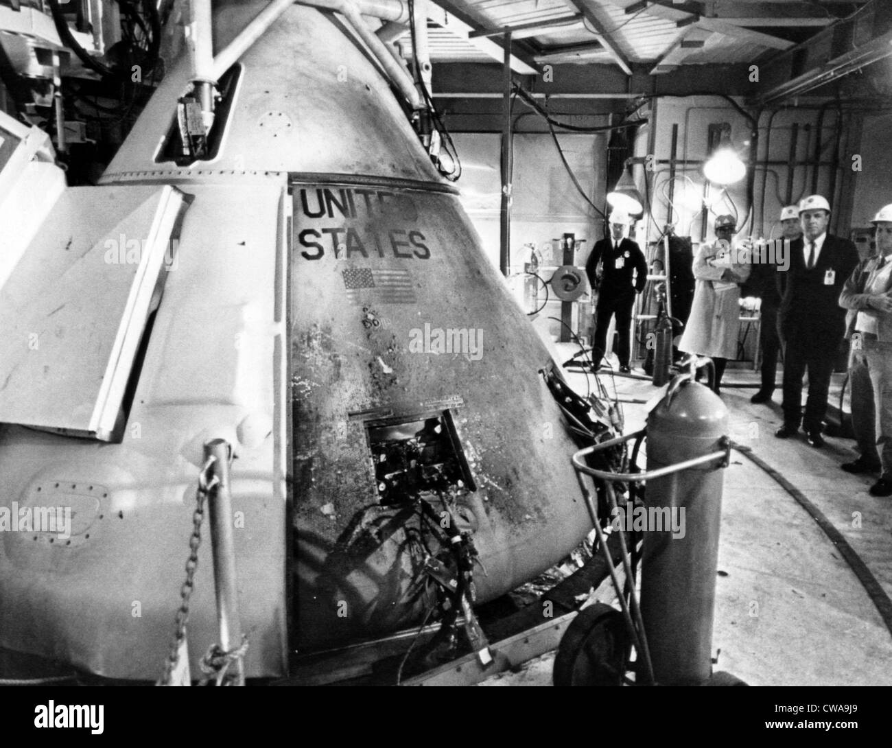 Technicians viewing the Apollo spacecraft where three flight crew members died during a launch simulation test, - Stock Image