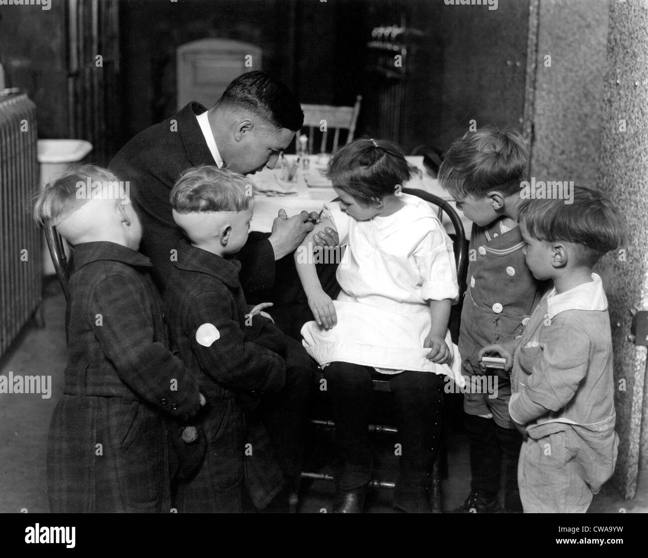 Children receiving vaccinations by Dr. John Davies, 1930's.. Courtesy: CSU Archives / Everett Collection - Stock Image