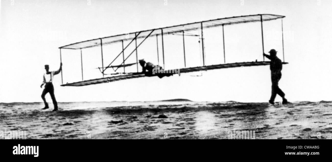 The modified No. 3 Glider (1902) being launched at Kill Devil Hill, with Orville Wright piloting as brother Wilbur - Stock Image