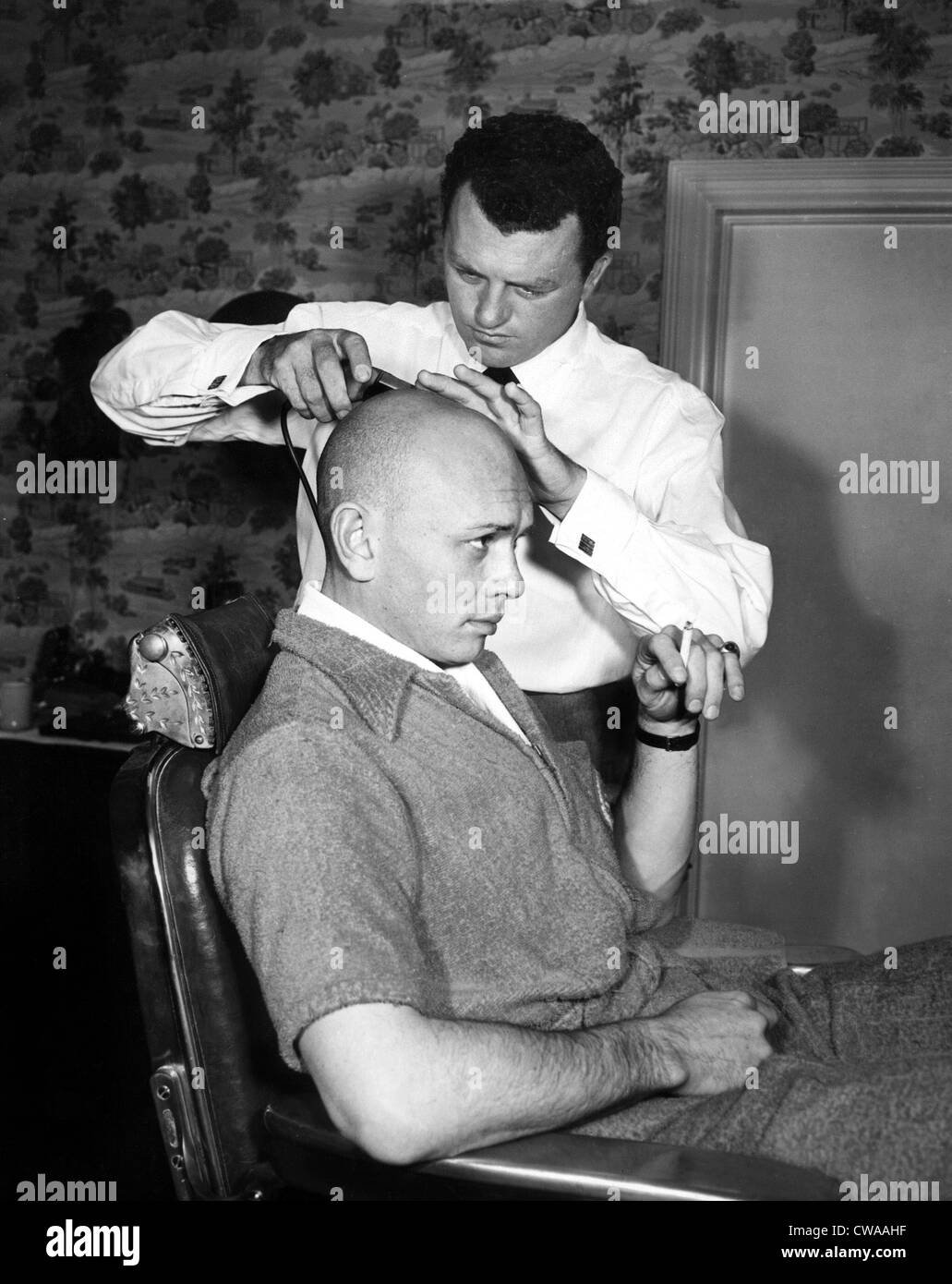 Yul Brynner getting shaved by Makeup Artist Robert Dawn for his role in THE KING & I, 1956, TM and Copyright © 20th Stock Photo