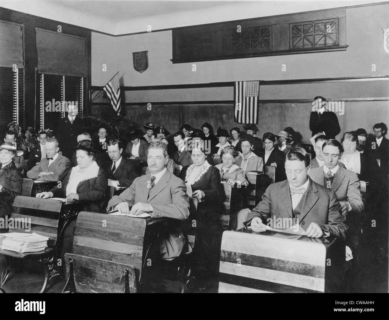Department of Labor naturalization class teaching immigrants English and US political culture in 1920. - Stock Image