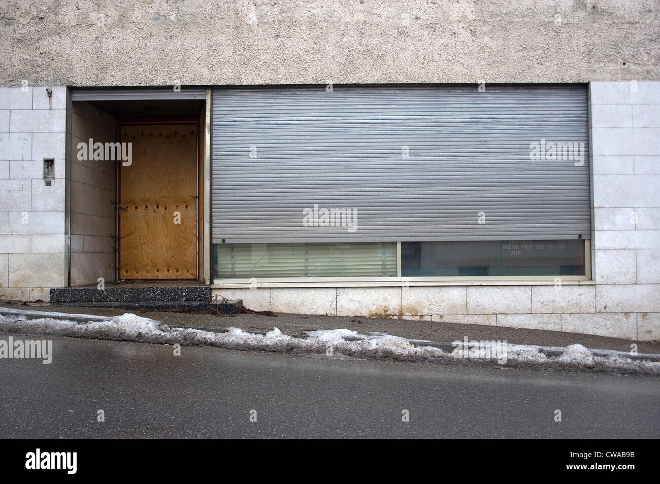 Riedlingen, closed business with lowered shutter - Stock Image