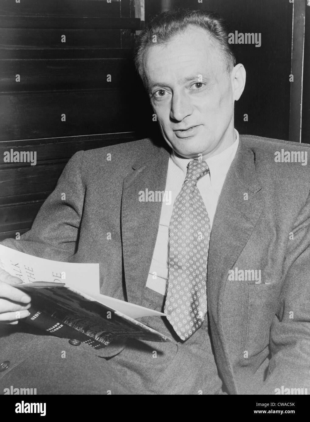 Nelson Algren (1909-1981), holding copy of his 1956 book 'A Walk on the Wild Side.' He won the National - Stock Image