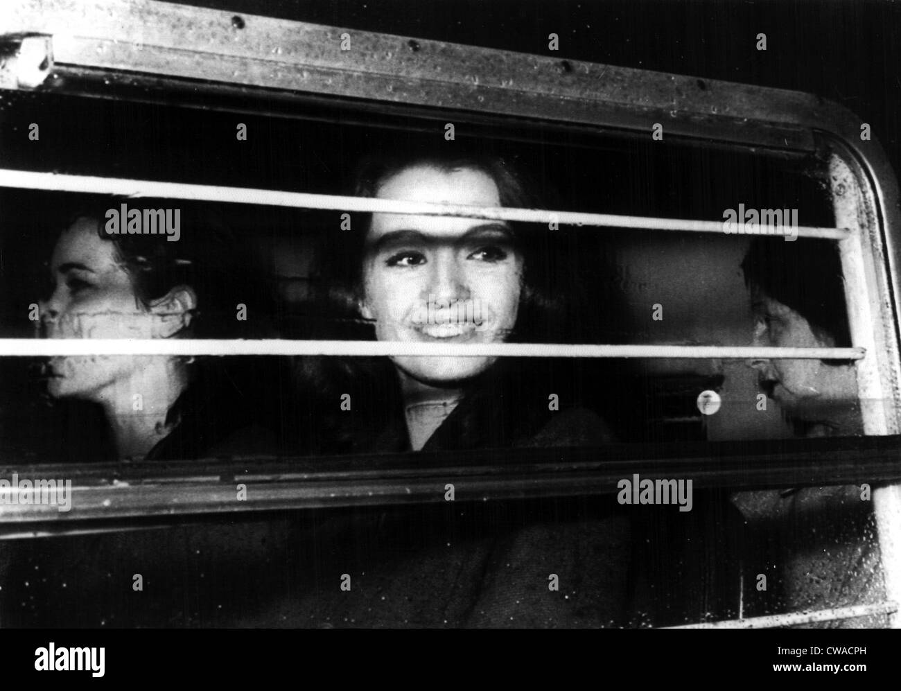 Christine Keeler, with Paula Hamilton-Marshall and Olive Brooker, taken in a police van for a hearing on charges Stock Photo