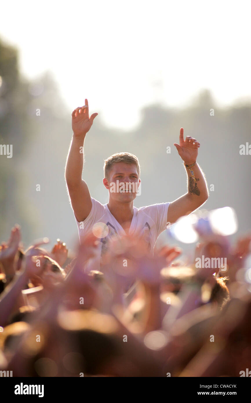A boy in the crowd enjoying the live music at the V Festival in Hylands Park, Chelmsford, Essex - Stock Image