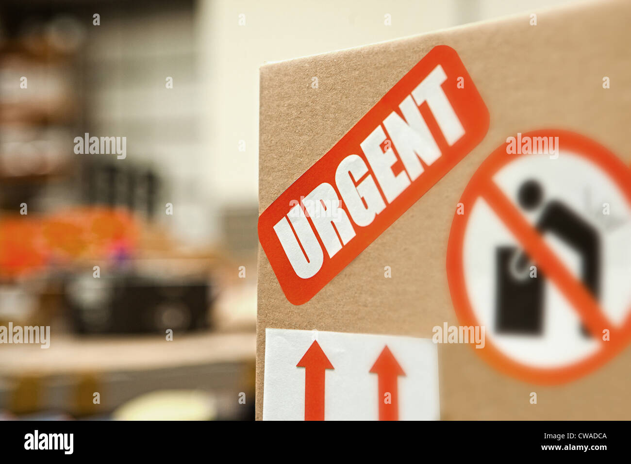 Cardboard box with warning stickers, close up - Stock Image