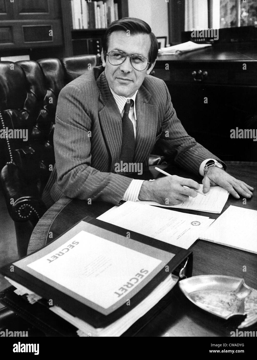 DONALD RUMSFELD, working in his office after the Senate confirmed his nomination to Secretary of Defense, 1975. - Stock Image