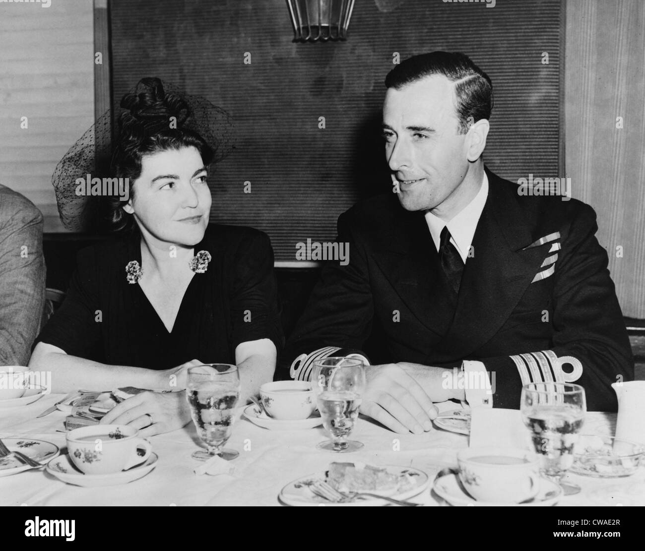 Irene Kuhn seated with Lord Louis Mountbatten at 1941 Overseas Press Club luncheon in his honor, New York City. - Stock Image