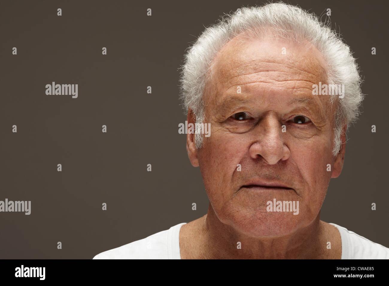 Contemplative senior man, portrait - Stock Image