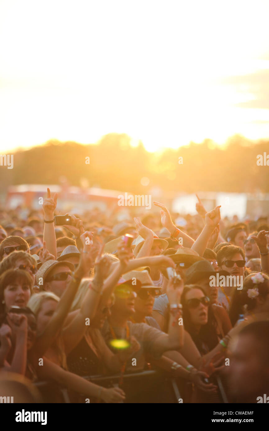 The crowd enjoying the live music at the V Festival in Hylands Park, Chelmsford, Essex - Stock Image