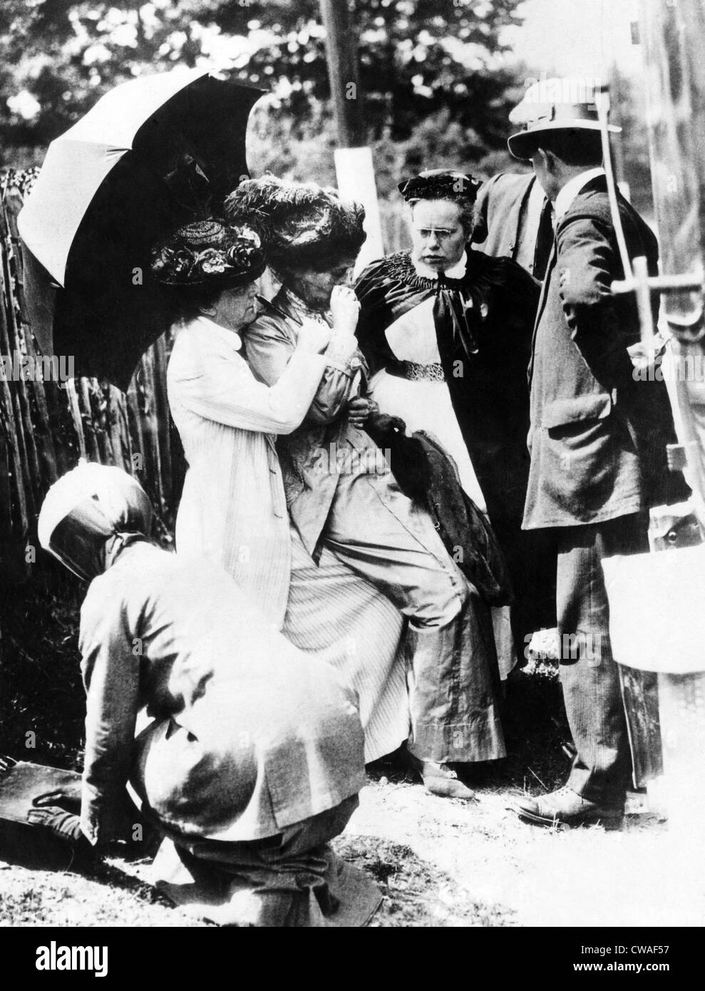 Emmeline Pankhurst (1858-1928, left of center), in a state of collapse afeter forcible feedings in jail, London, - Stock Image