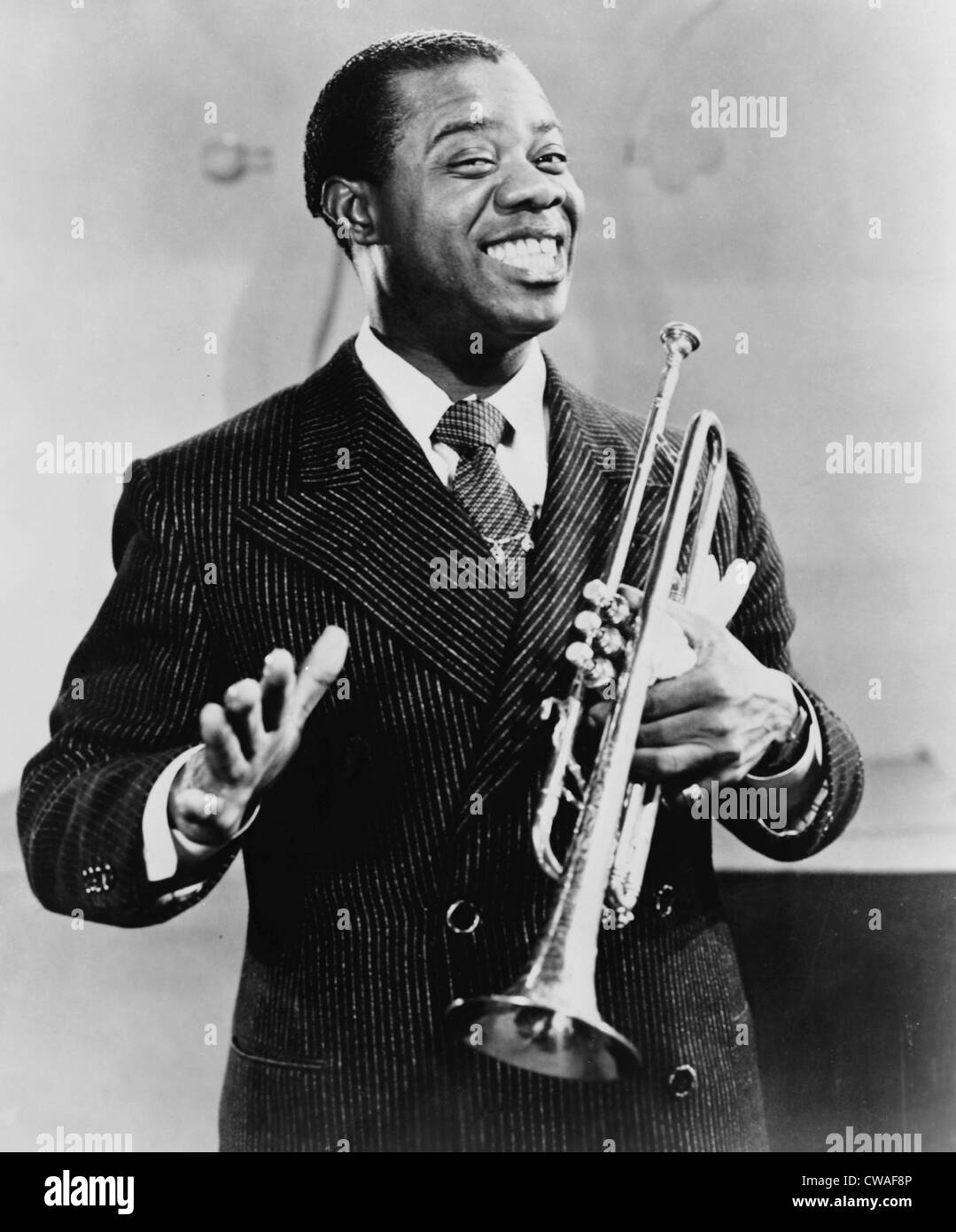 Louis Armstrong (1901-1971), African American Jazz musician, holding his trumpet, 1948. Stock Photo