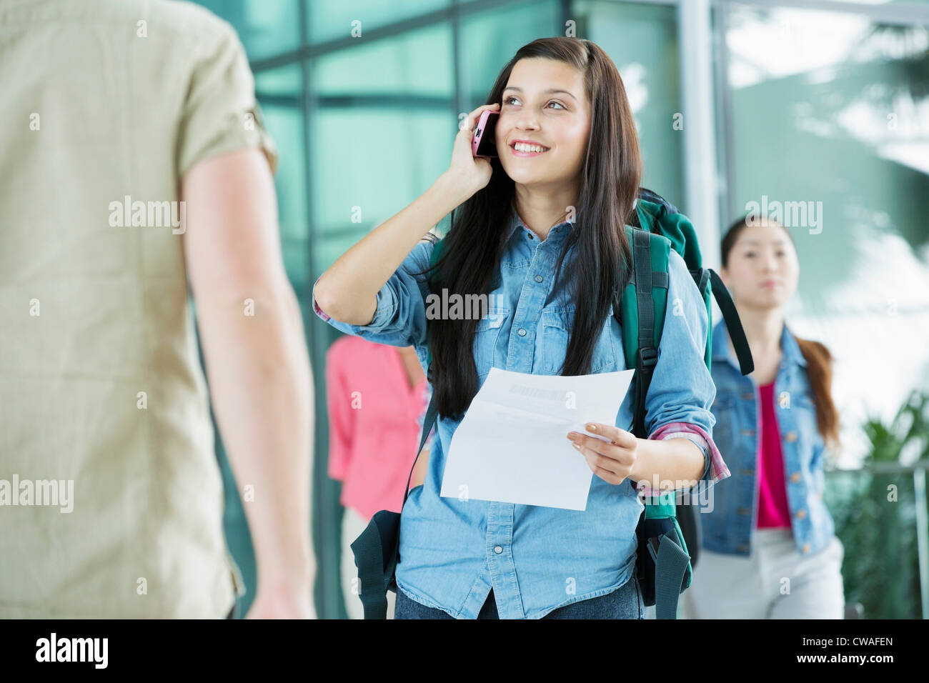 Young female backpacker in airport - Stock Image