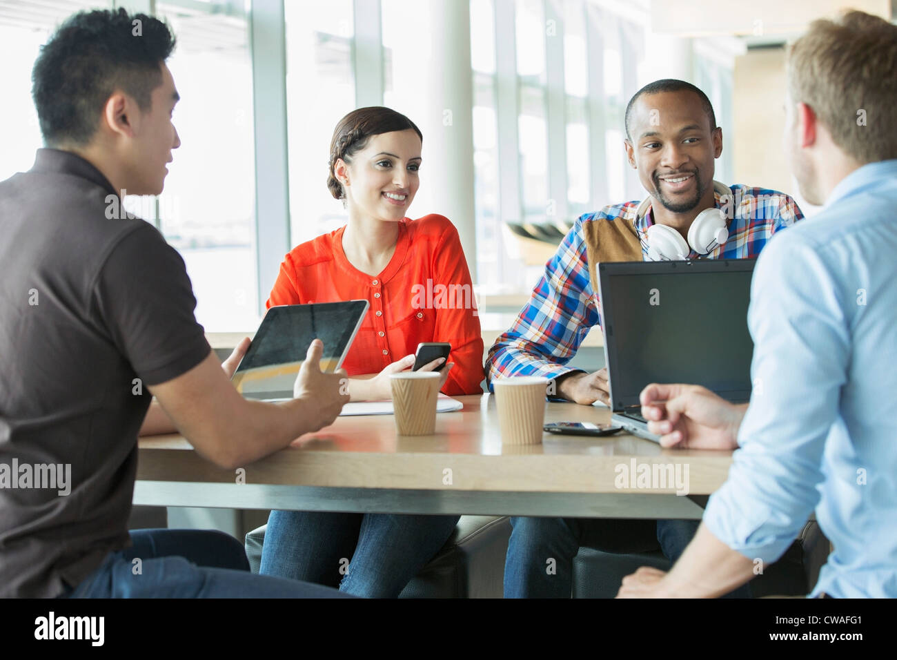 Young business people in meeting - Stock Image