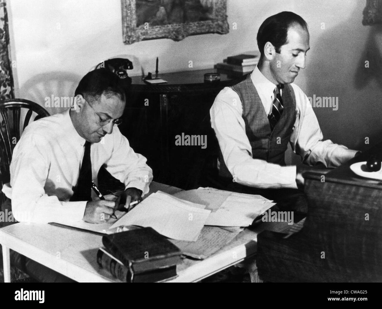 Ira and George Gershwin at work on a film score. ca. early 1930s. Courtesy: CSU Archives/Everett Collection. - Stock Image