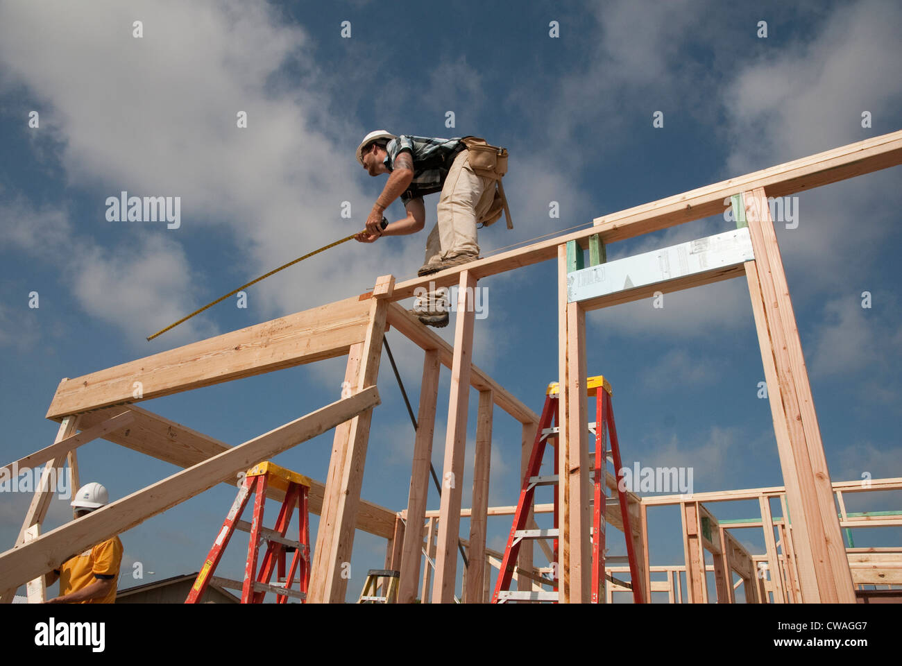 Company employees volunteer their time, help build an affordable house with Habitat for Humanity in Austin, Texas - Stock Image