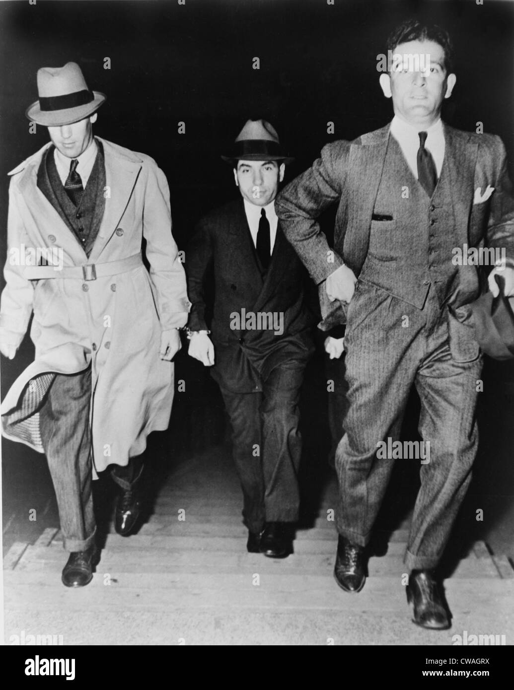 Lucky Luciano (1896-1962), being escorted into court by two detectives in 1936.  Luciano was sentenced to 30-to Stock Photo