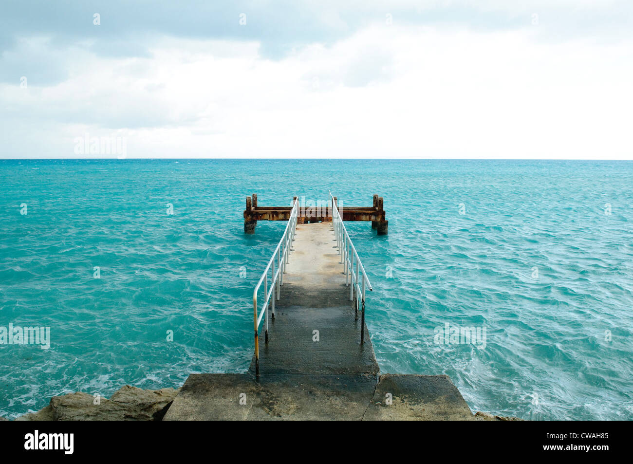 Pier going into blue sea, St. George's Parish, Bermuda - Stock Image