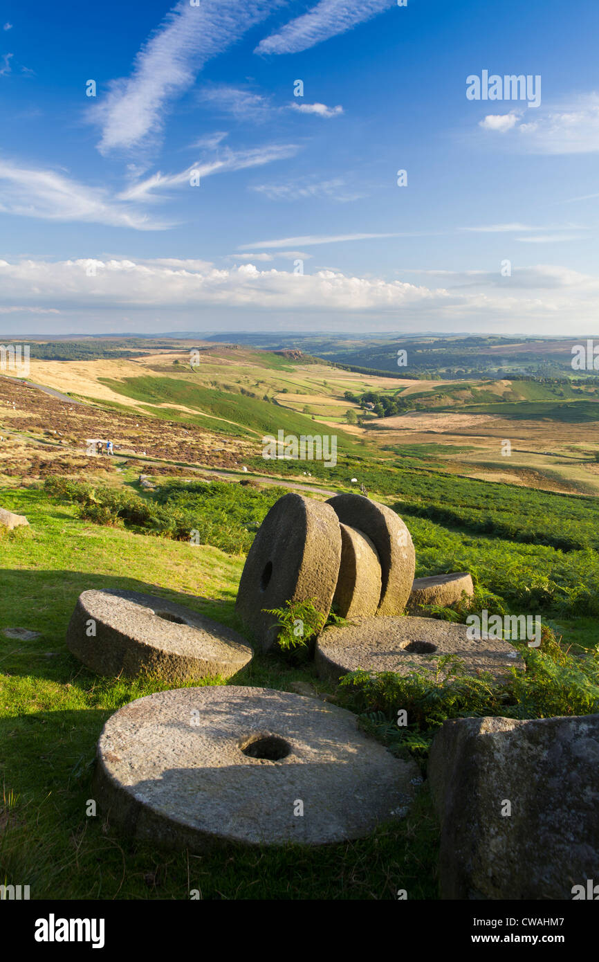 Abandoned millstones below Stanage Edge, Peak District, Derbyshire, England, UK - Stock Image