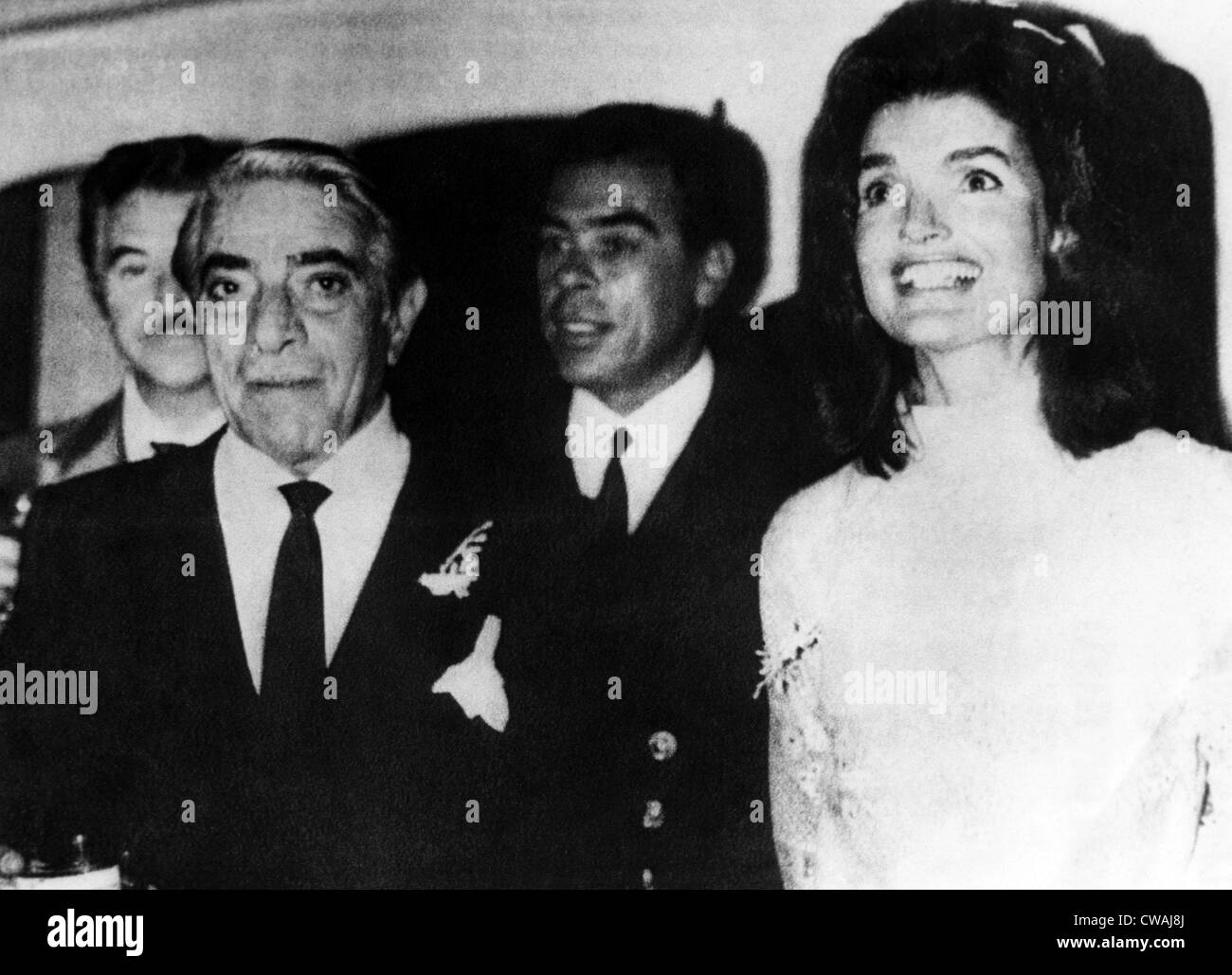 Aristotle Onassis (front left), former First Lady Jacqueline Kennedy Onassis (right), following their wedding on - Stock Image