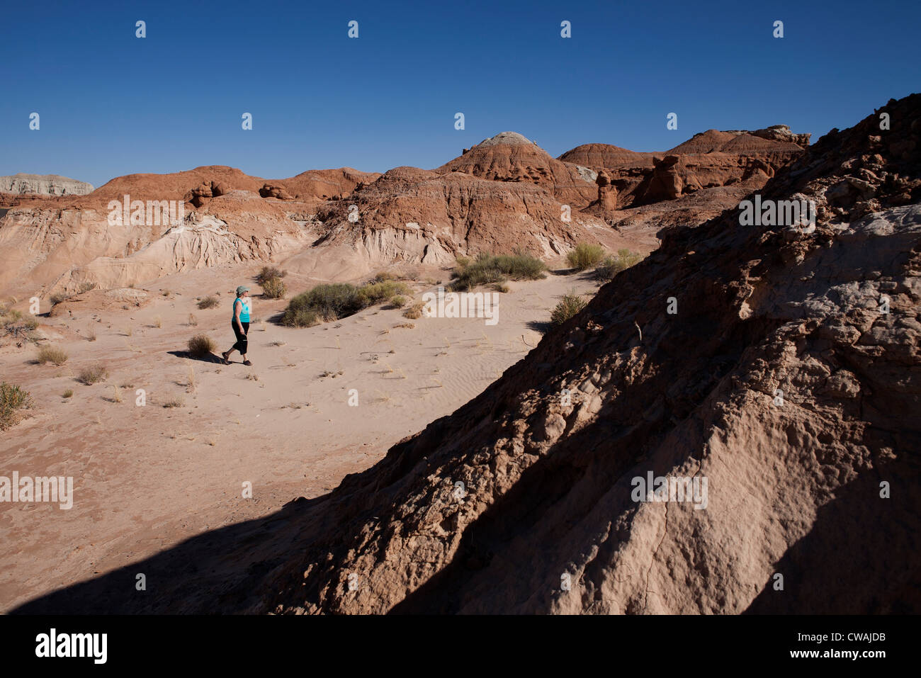 Woman walking in the desert of Goblin Valley State Park,Emery, Utah, USA - Stock Image