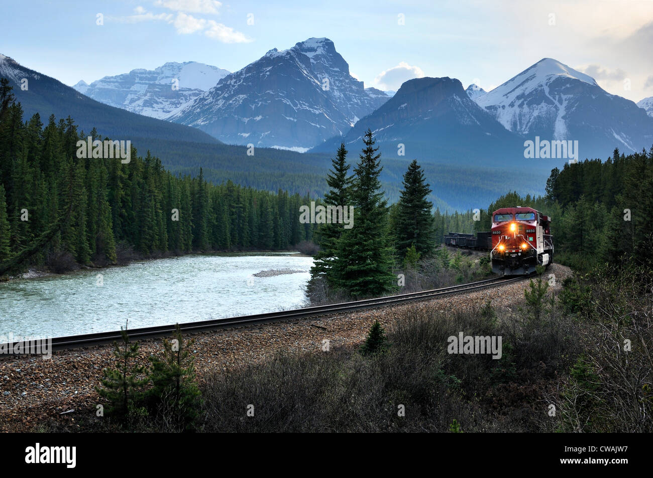 Eastbound train and Bow Range, Banff National Park, Alberta, Canada - Stock Image