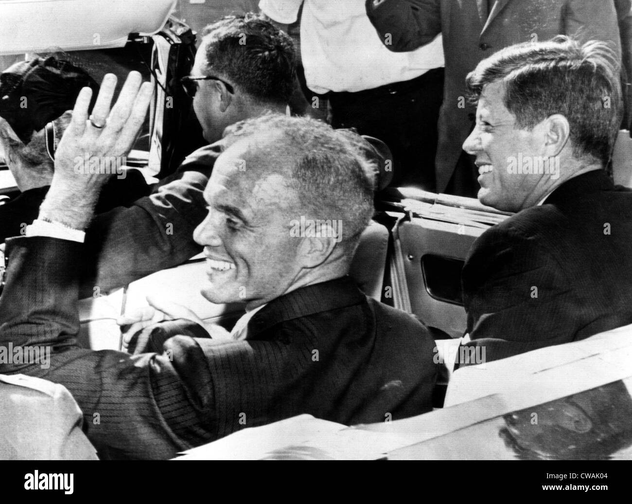 Astronaut John Glenn and President John F. Kennedy wave and smile to a cheering crowd.Cape Canaveral, Florida, February - Stock Image