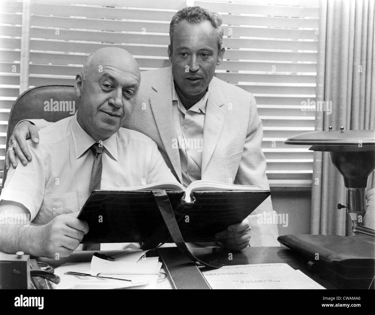 Otto Preminger, director & Leon Uris, writer, review script to EXODUS, 1958. Courtesy: CSU Archives / Everett - Stock Image