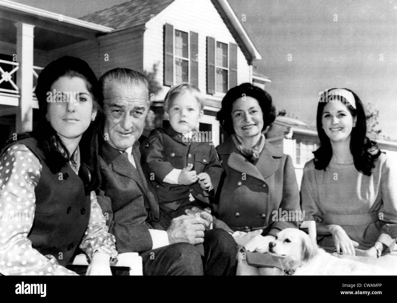 The first family pose for pictures on the front lawn of the LBJ Ranch shortly after attending Thanksgiving services - Stock Image
