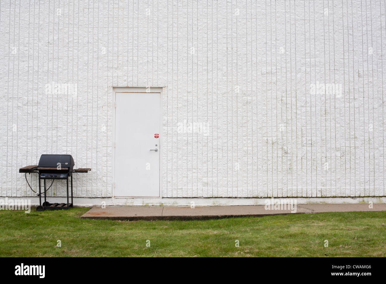 Barbecue and white building exterior - Stock Image