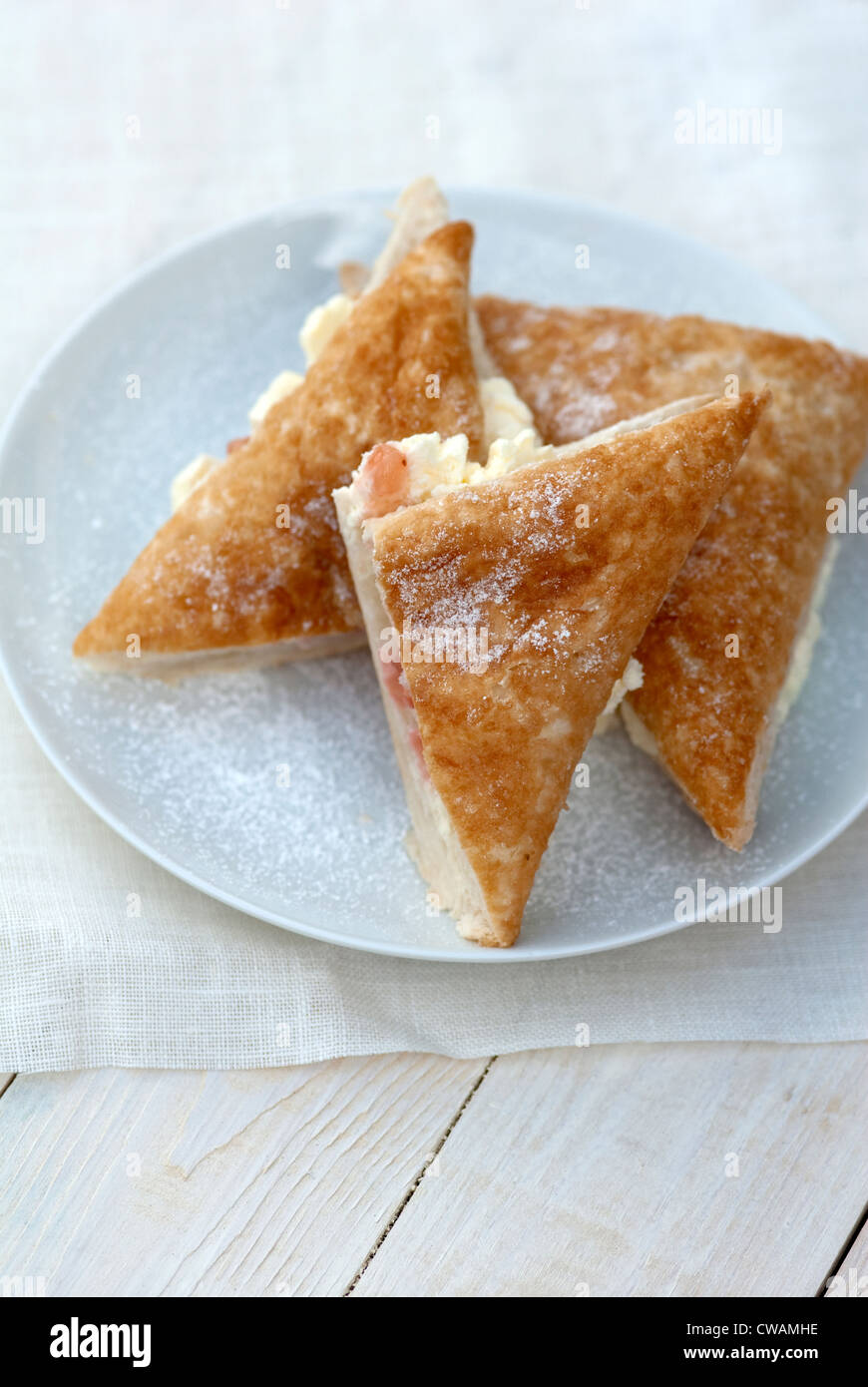 food photography of apple and strawberry cream turnover bun - Stock Image