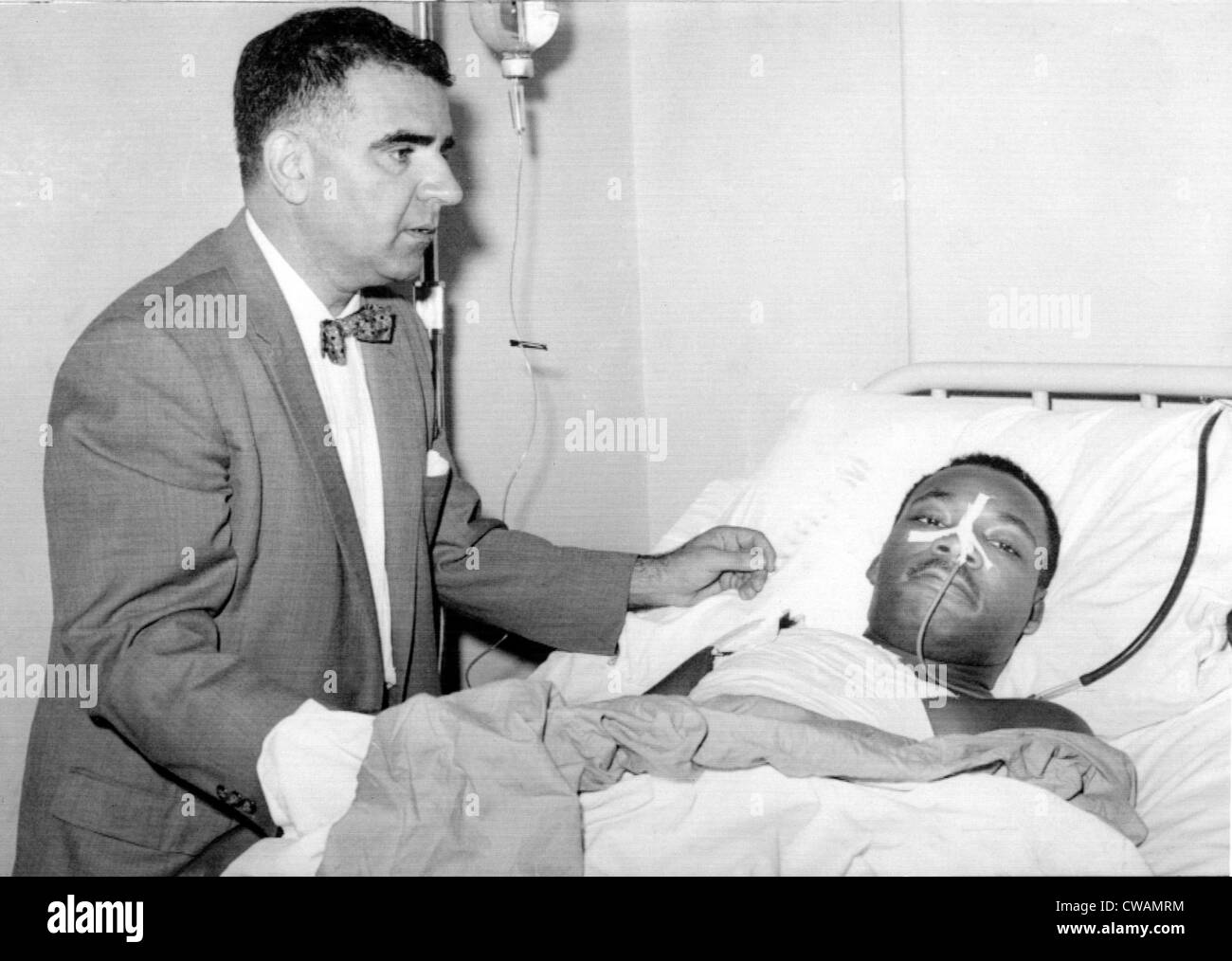 Martin Luther King Jr. in Harlem Hospital after stabbing in chest by letter opener, attended by Dr. Emil Naclerio, - Stock Image