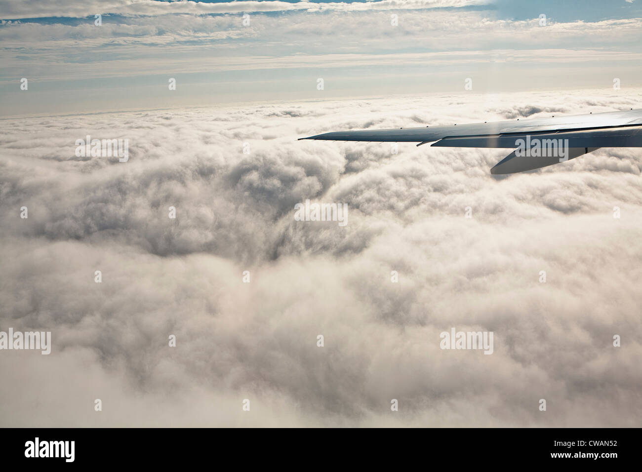 Aeroplane wing and clouds - Stock Image