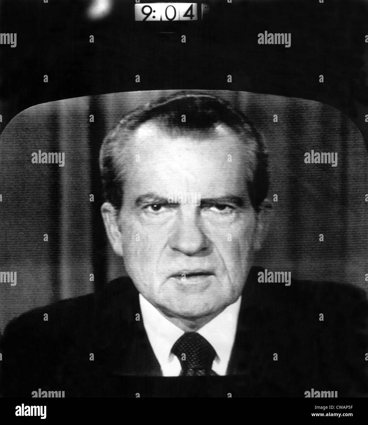 President Richard Nixon, with digital clock indicating the exact minute he resigned the Presidency, 08/08/74. Courtesy: - Stock Image