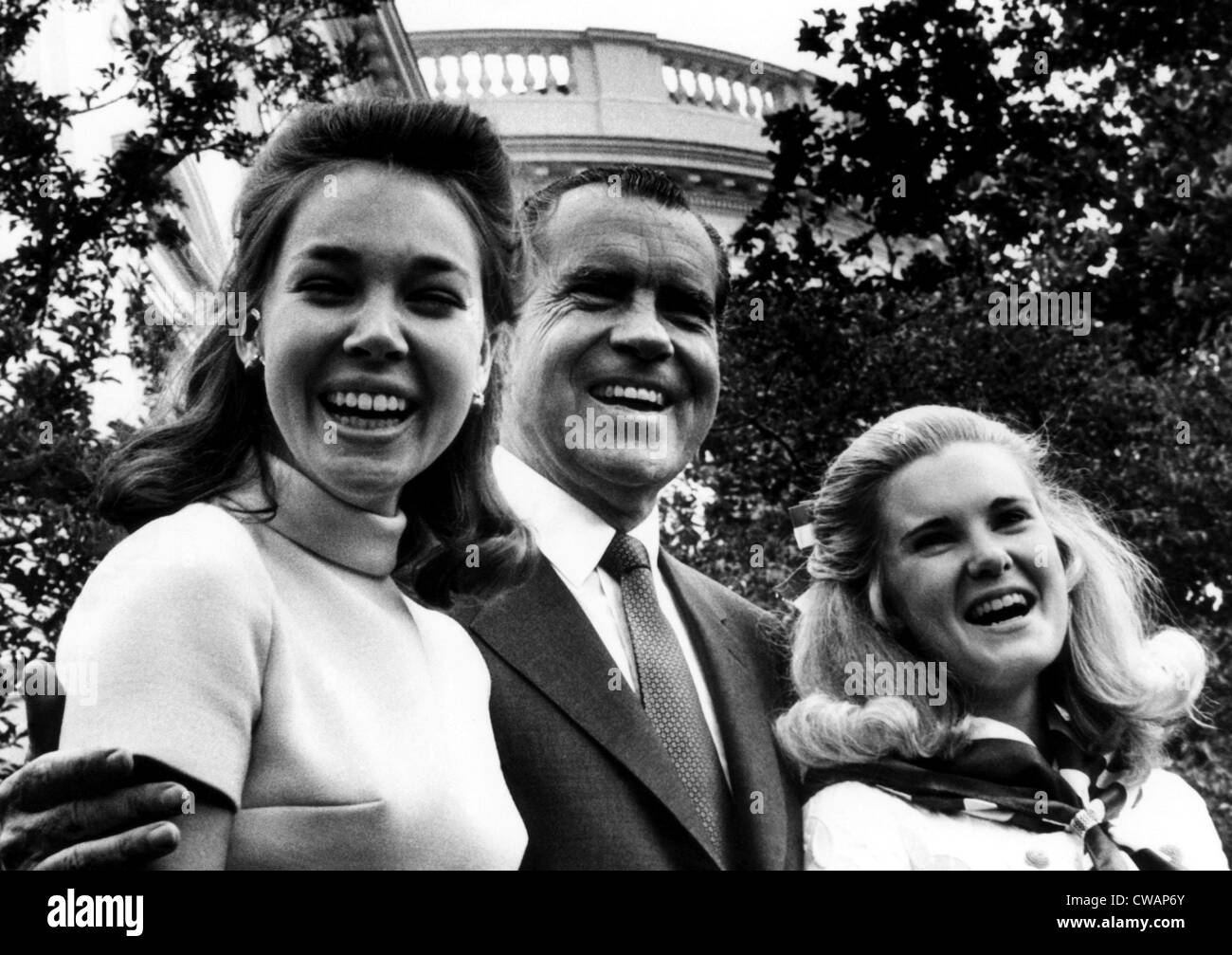 U.S. President Richard Nixon (center), with his daughters Julie Eisenhower (left), and Tricia Nixon, on Father's - Stock Image