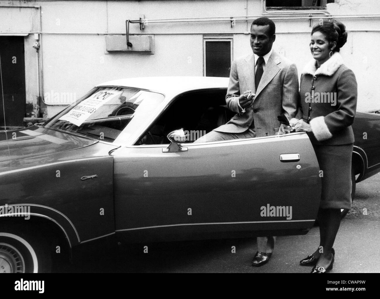 Baseball player Roberto Clemente and his wife, Vera, admire the new car he received for his performance in the 1971 - Stock Image