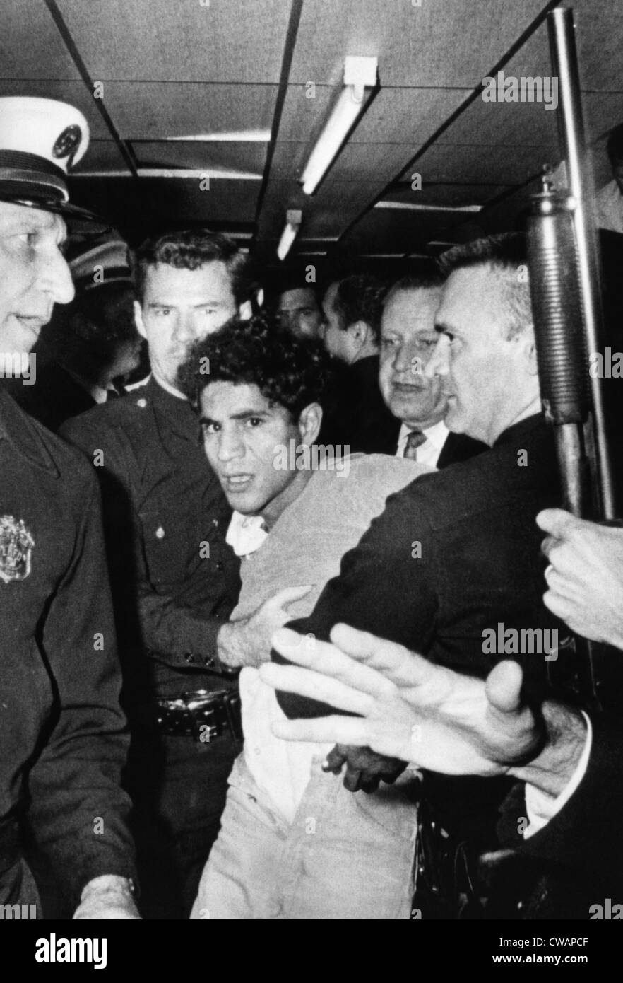 Sirhan Sirhan, the suspect in the shooting of Senator Robert F. Kennedy, being hustled out of the Ambassador Hotel, - Stock Image