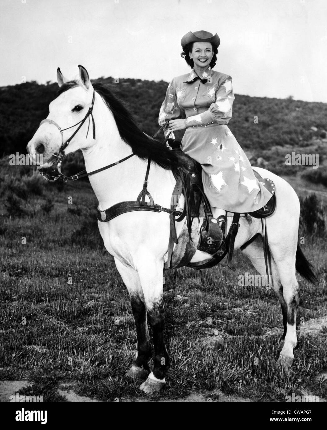 Dale Evans (1912-2001), American actress, singer and wife of Roy Rogers, with her horse Buttermilk, circa 1956. - Stock Image