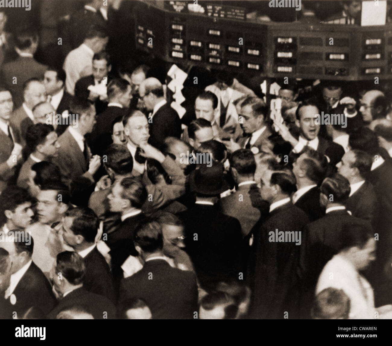 Stock traders on the floor of the New York Stock Exchange in 1936. - Stock Image