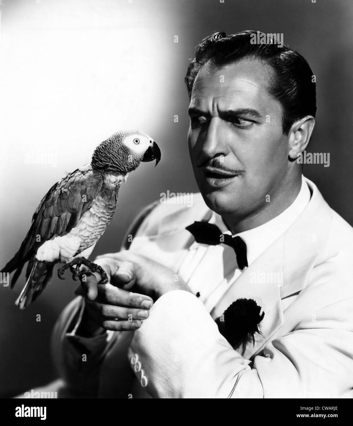 CHAMPAGNE FOR CAESAR, Vincent Price, and Caesar the parrot, 1950. Courtesy: CSU Archives/Everett Collection - Stock Image