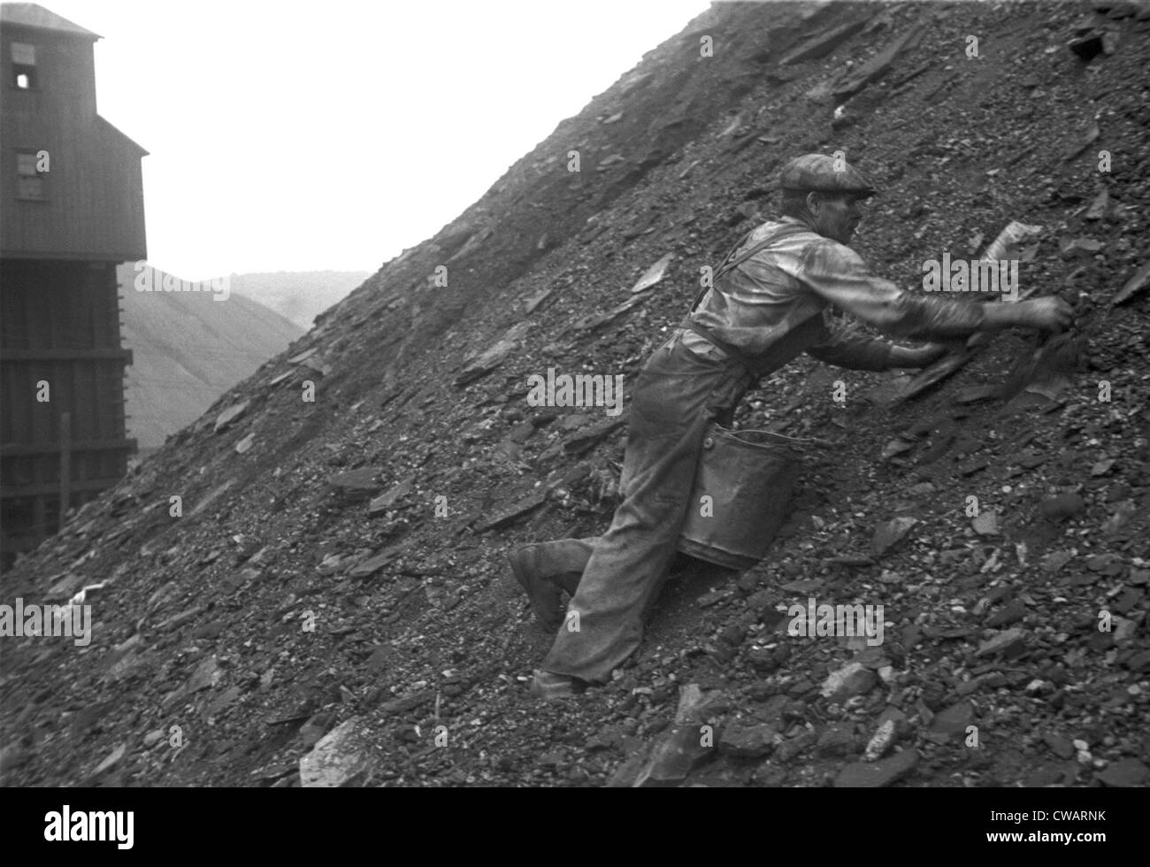 During the Great Depression a man salvages good coal from slag heaps at Nanty Glo, Pennsylvania, for which he is - Stock Image
