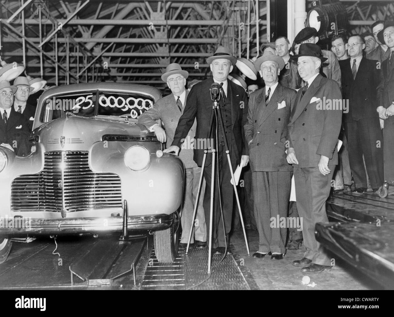 William S. Knudsen (1879-1948), presided over the 25,000,000th car to come off the General Motors had recently been - Stock Image