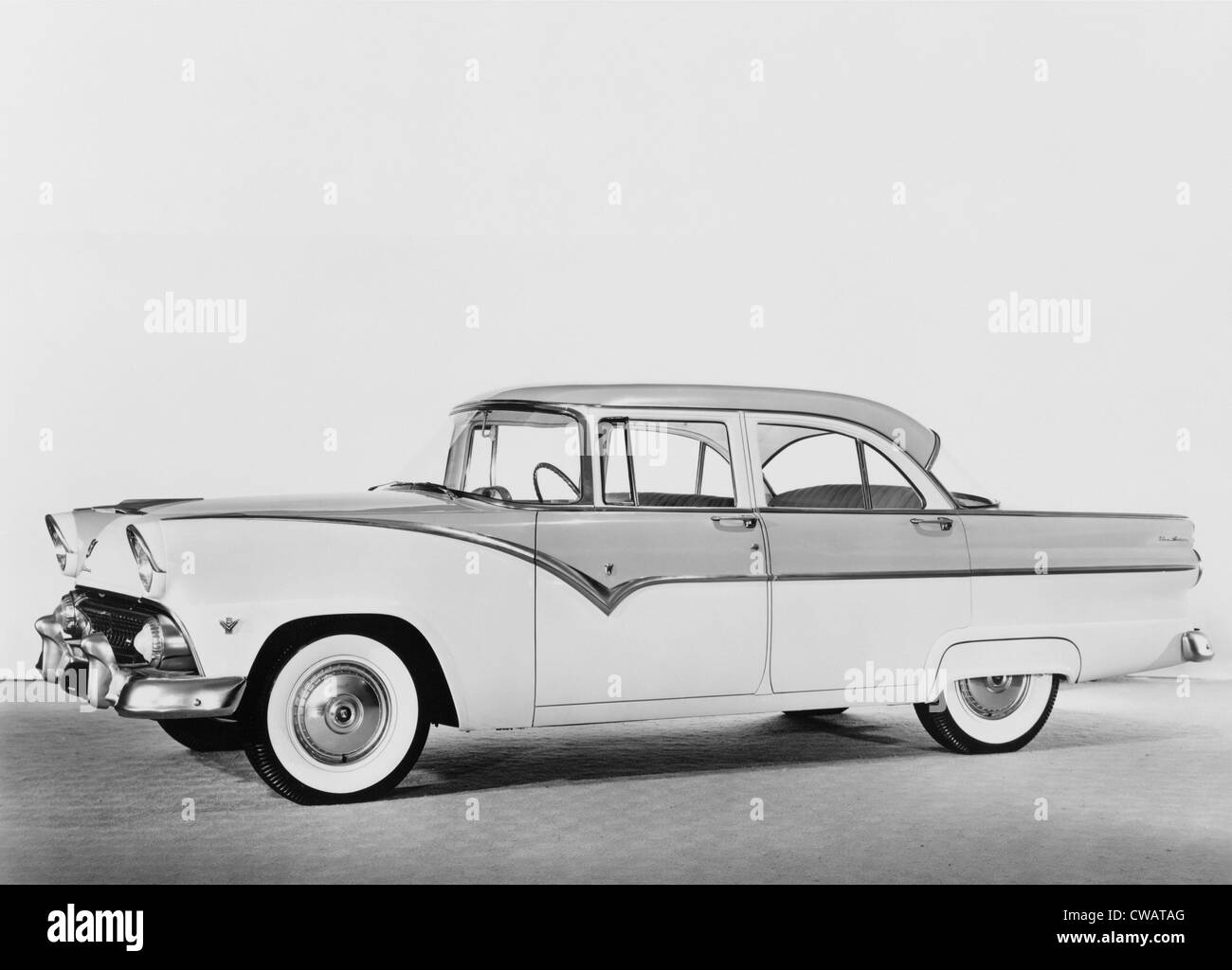 1955 Ford four-door sedan featured two-tone paint, heavy chrome detail, white wall tires, wrap around windshield, - Stock Image