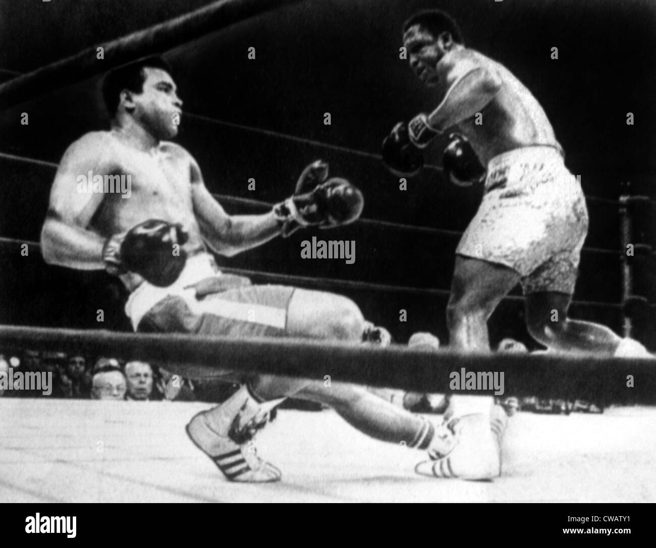 Muhammad Ali knocked down by Joe Frazier in their first title match in Madison Square Garden, 1971. Courtesy: CSU - Stock Image