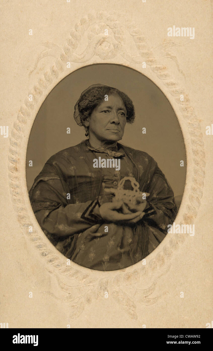 Well dressed middle aged, African American women holding a basket in the Post Civil War era.  Ca. 1870. - Stock Image