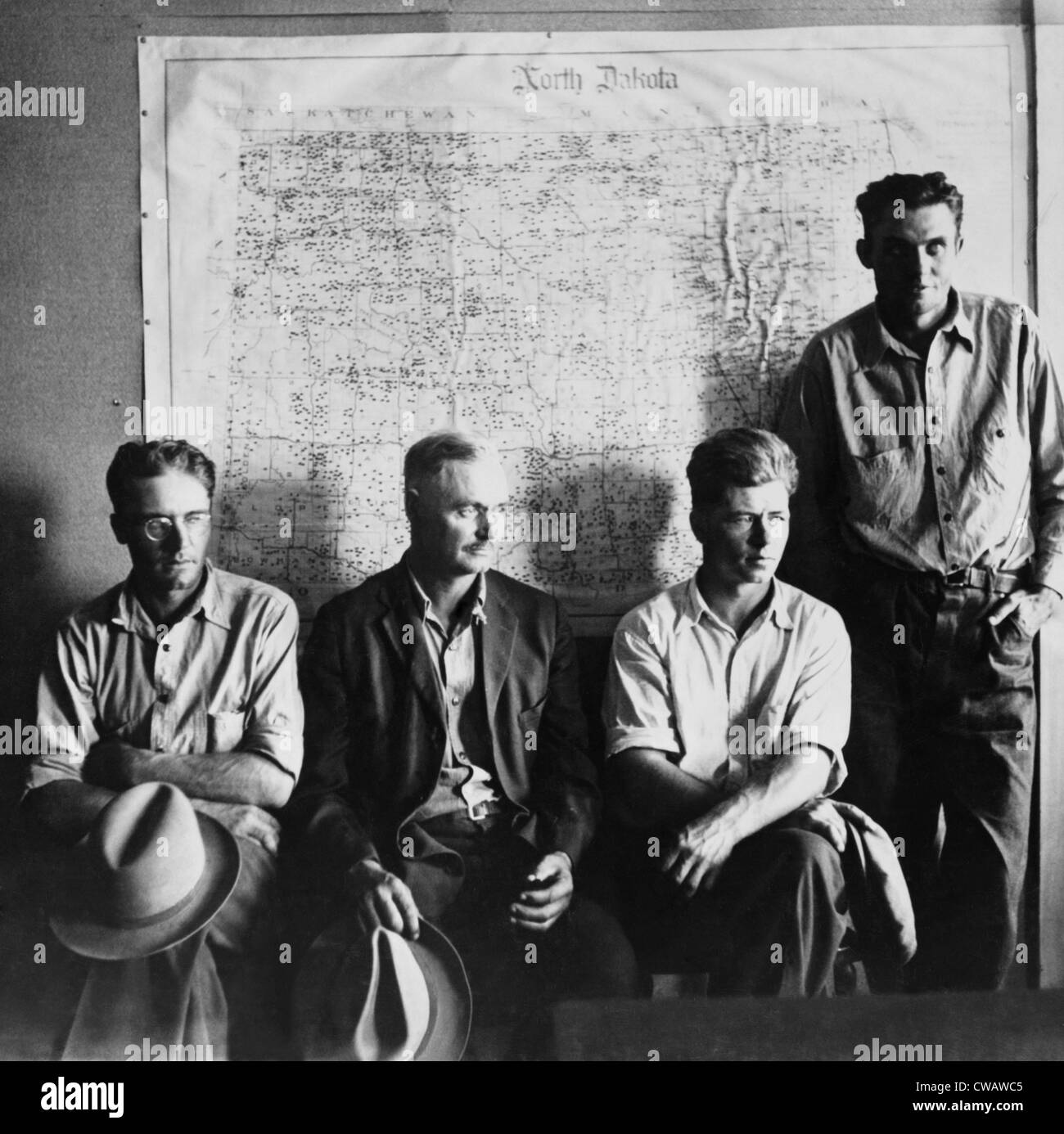 North Dakota farmers waiting for their grants in a Resettlement Administration Office, precursor of the Farm Security - Stock Image